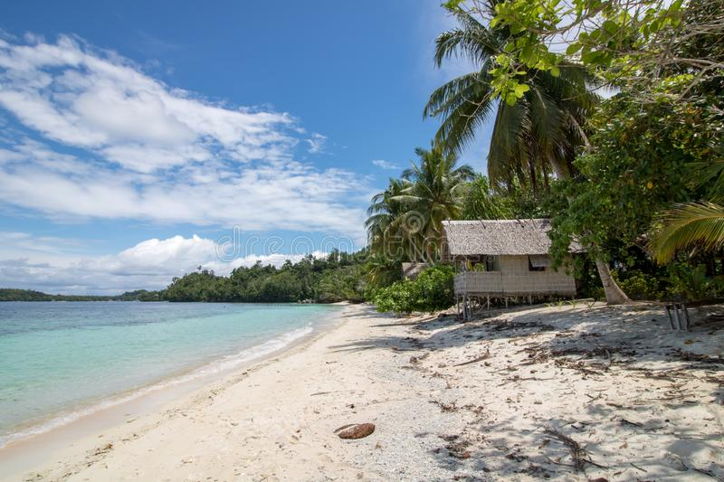 Wild beach with straw bungalows  in raja ampat island. West papua royalty free stock image