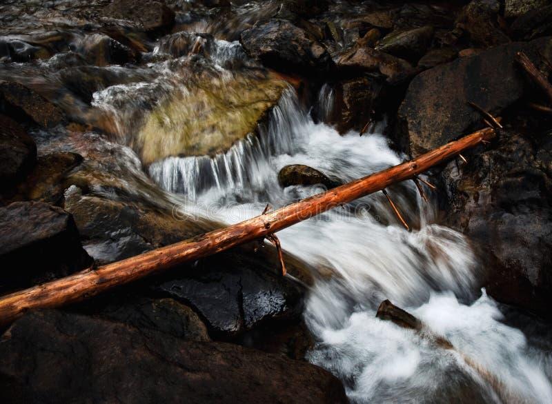 Wild brook between rocks royalty free stock photo