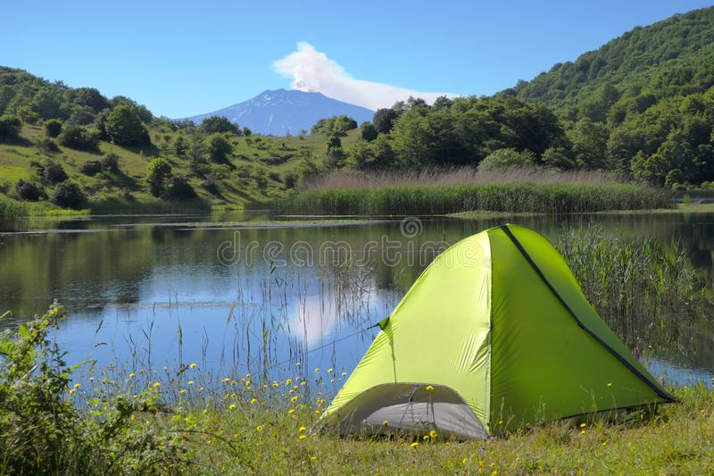 Wild Camp On Lake In Nebrodi Park, Sicily. Wild camp on Biviere Lake in Nebrodi Park, on background Etna Mount, Sicily royalty free stock photography