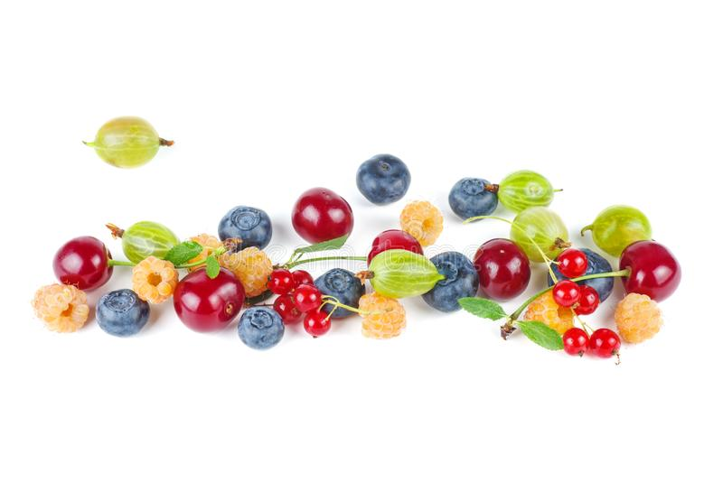 Wild cherry, red currants, green gooseberry,yellow raspberry and blueberries isolated on white background. Food for vegan royalty free stock photography