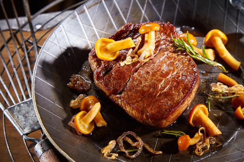 Wild deer venison steak with forest mushrooms royalty free stock images