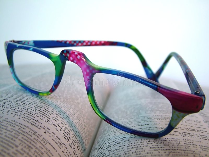 Wild Dictionary. A pair of wild colored reading glasses on a page of a dictionary