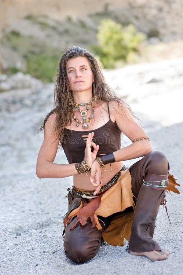 Wild Fashion. Woman coruching wearing artisan made leather pants and jewelry stock images