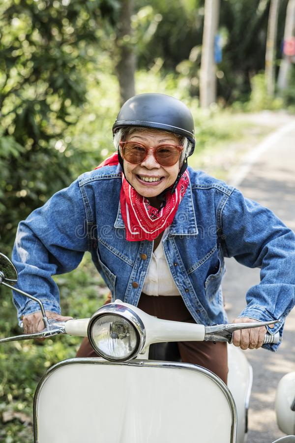 Wild and free senior woman royalty free stock photography