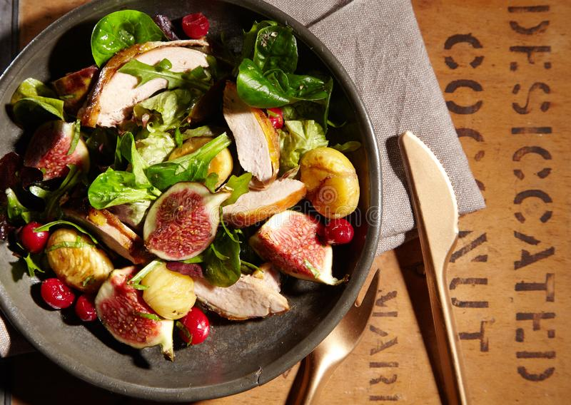 Wild game salad with pheasant, chestnuts and figs royalty free stock photo