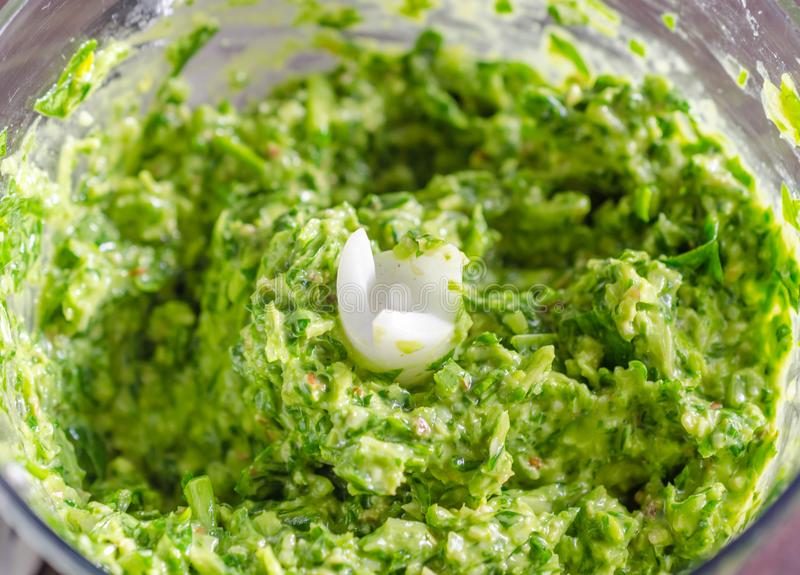 Wild garlic pesto. Fresh green Wild garlic also called ramsons pesto background stock image