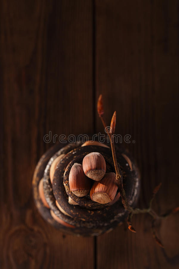 Download Wild Hazelnut In Iron Bowls Stacked On Wooden Table Stock Image - Image: 35375859
