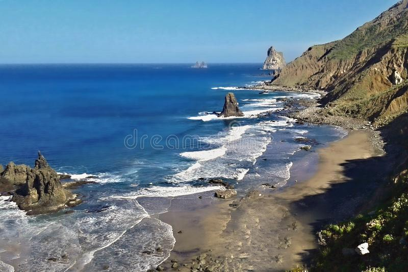 Wild and lonely beach in the romantic Anaga mountains of the Canary island of tenerife near the village of Benijo. Deep Atlantic with sharp volcanic stones and royalty free stock images