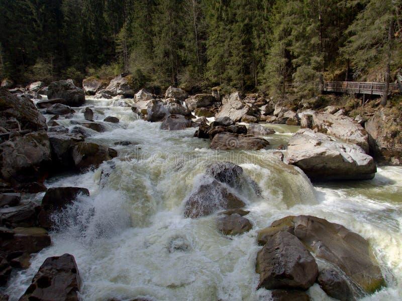 Wild mountain creek with stones stock photo