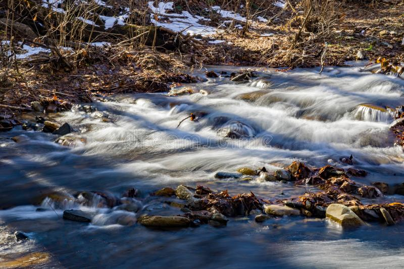 Wild Mountain Trout Stream in the Shadows. Located in the Rock Castle Gorge located in the Blue Ridge Mountains in Floyd County, Virginia, USA stock image