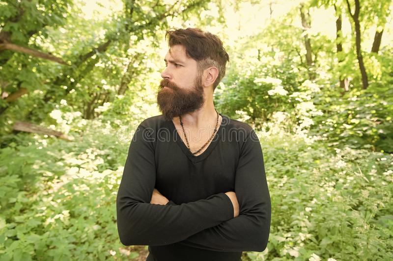 Wild nature. Man bearded hipster bright foliage background. Guy relax in forest. Exploring nature. Handsome man with royalty free stock images