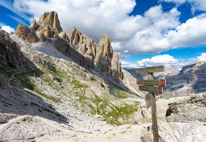 Wild and picturesque mountain landscape with wooden trail marker in the foreground stock photo