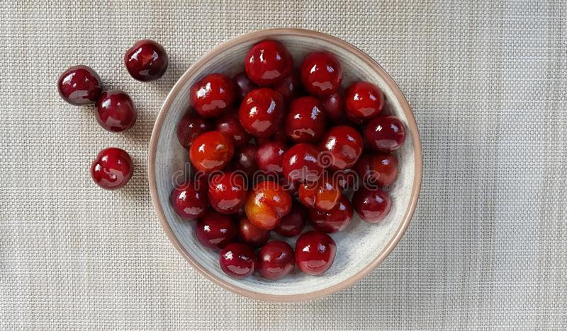 Wild Plum in bowl,put on napery with clipping path stock image