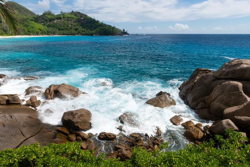 Wild Seychelles lagoon with rocks and greens royalty free stock photography