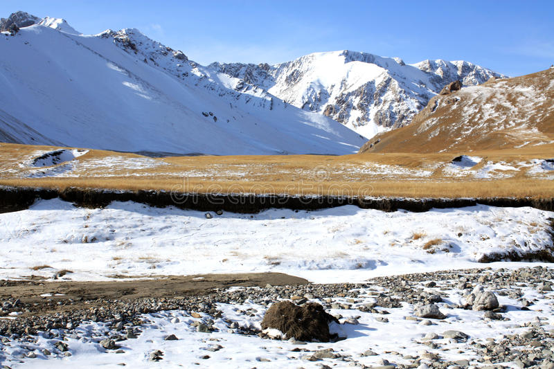 Wild Snow Mountains at Kyrgyzstan. Sary-Chat State reserve stock photography