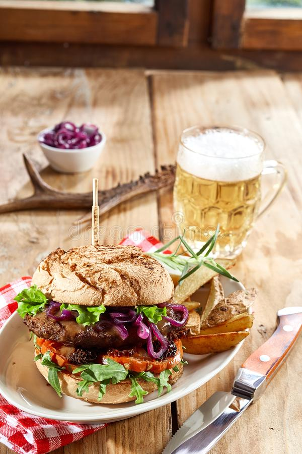 Wild venison beef burger with salad trimmings stock image
