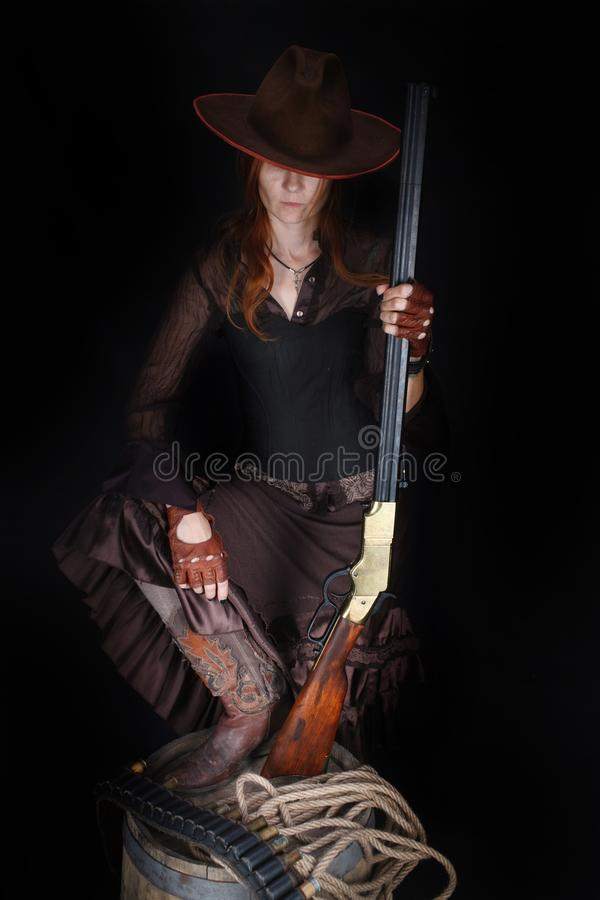 Wild west girl with rifle stock photography