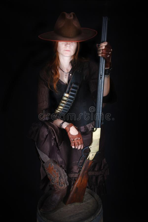 Wild west girl with rifle royalty free stock image