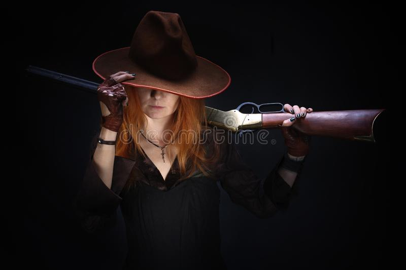 Wild west girl with rifle royalty free stock photos