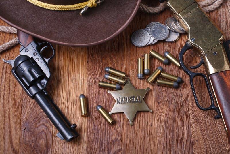 Wild west gun, ammunition and U.S. Marshal Badge royalty free stock photo