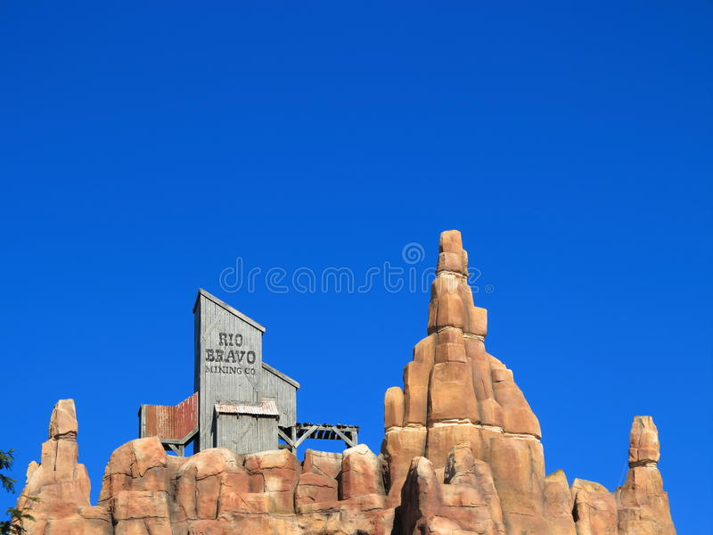 Wild west mountain top setting at rich blue sky