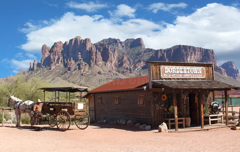 Wild West. Old Wild West Cowboy town with horse drawn carriage and mountains in background stock photography