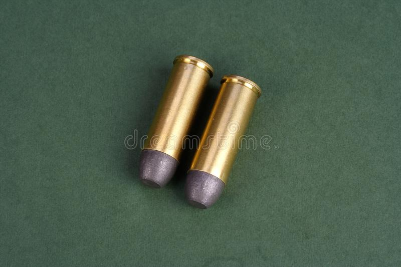 The Wild West period Revolver cartridges dating to 1872. On green background royalty free stock images