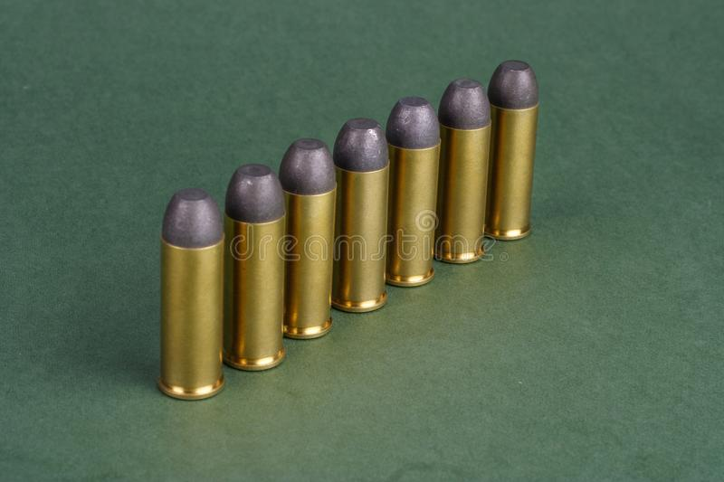 The Wild West period Revolver cartridges dating to 1872. On green background royalty free stock photo