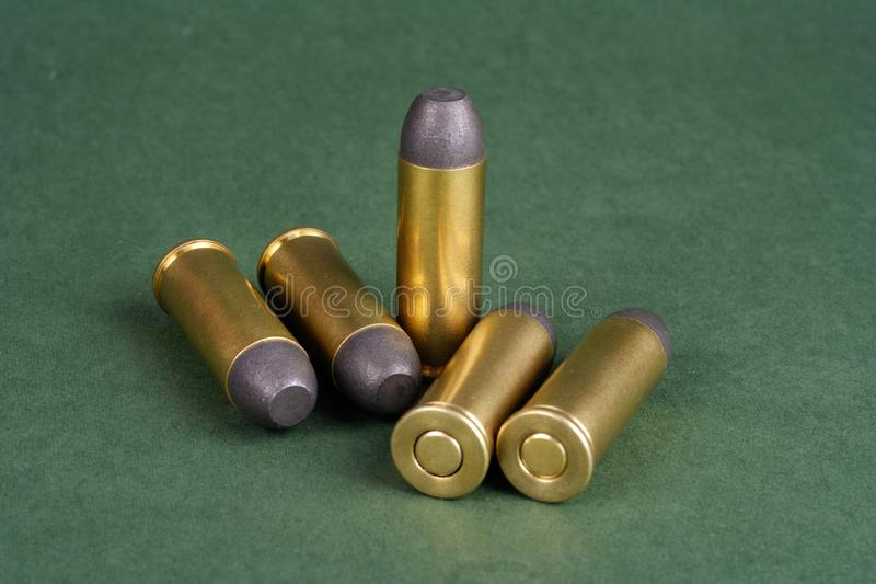 The Wild West period Revolver cartridges dating to 1872. On green background royalty free stock image