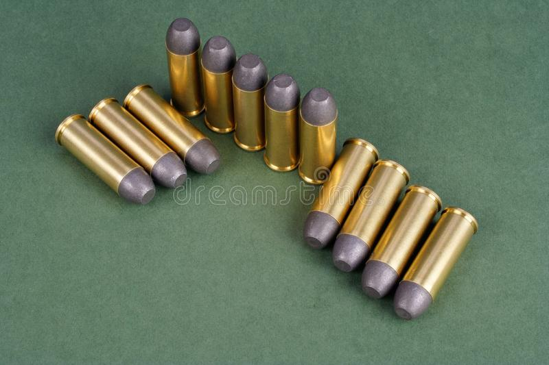 The Wild West period Revolver cartridges dating to 1872. On green background stock images