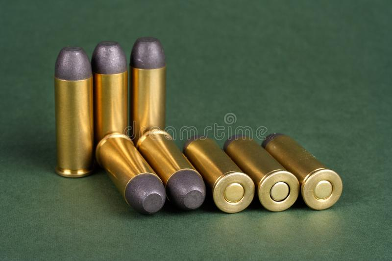 The Wild West period Revolver cartridges dating to 1872. On green background stock photos