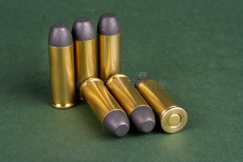 The Wild West period Revolver cartridges dating to 1872. On green background stock photography