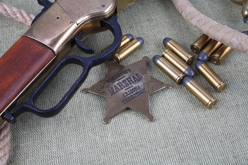 Wild west rifle, ammunition and sheriff badge stock photo