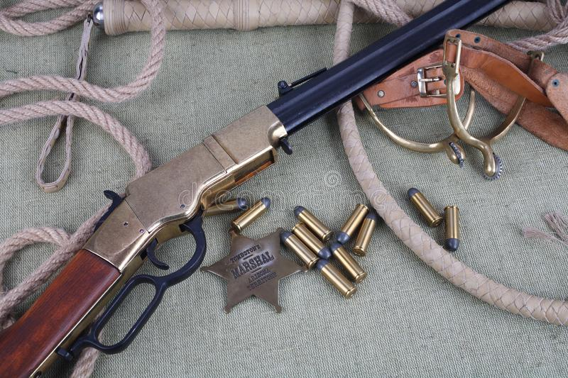 Wild west rifle, ammunition and sheriff badge royalty free stock photos