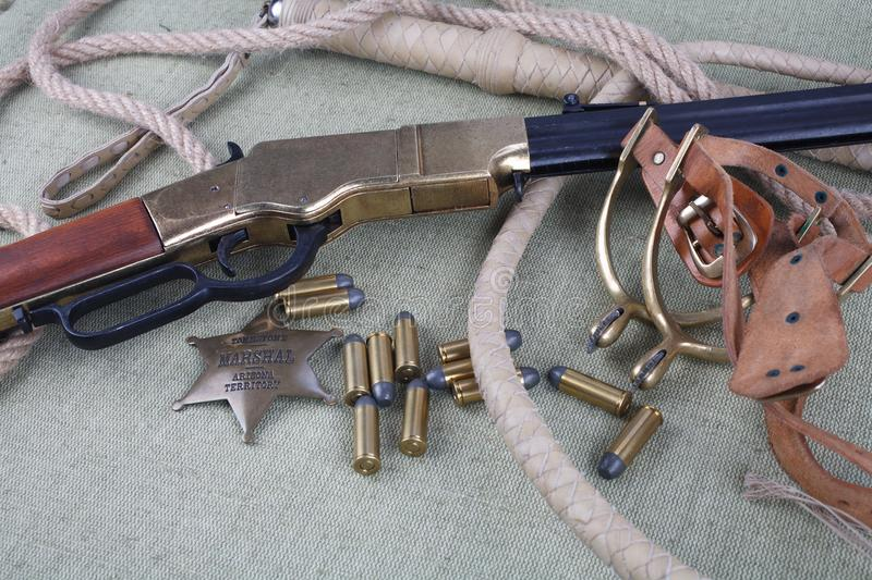 Wild west rifle, ammunition and sheriff badge stock photos