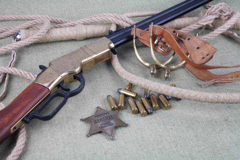 Wild west rifle, ammunition and sheriff badge royalty free stock image