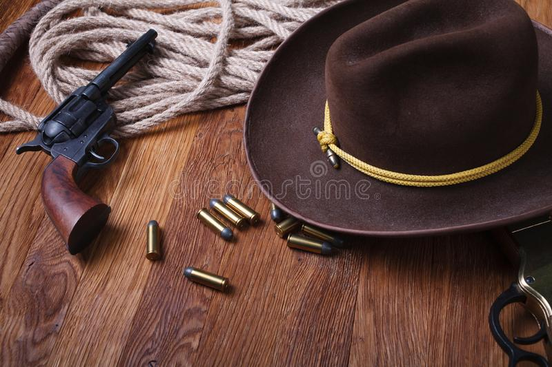 Wild west rifle, ammunition and sheriff badge. On wooden table royalty free stock photos