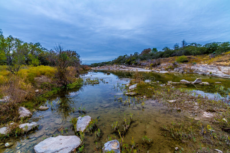 Wild Western Landscape of the Texas Hill Country. Crystal Clear Stream Flowing Through the Texas Hill Country with Autumn Colors on an Overcast Sleepy Day stock photos