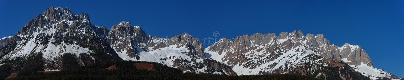 Wilder Kaiser mountains in Spring at tyrol, Austria. Springtime Panorama of the Wilder Kaiser Mountain Range in Tyrol stock images