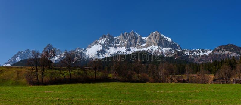 Wilder Kaiser mountains in Spring at tyrol, Austria. Springtime Panorama of the Wilder Kaiser Mountain Range in Tyrol royalty free stock images