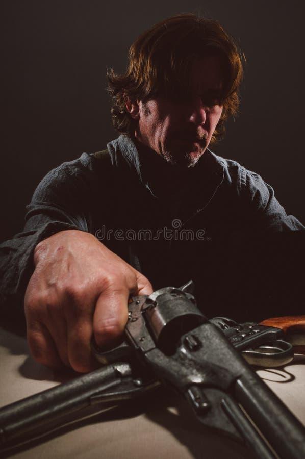 Wilder Westpistolenheld stockfotos