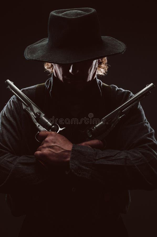 Wilder Westpistolenheld stockbilder