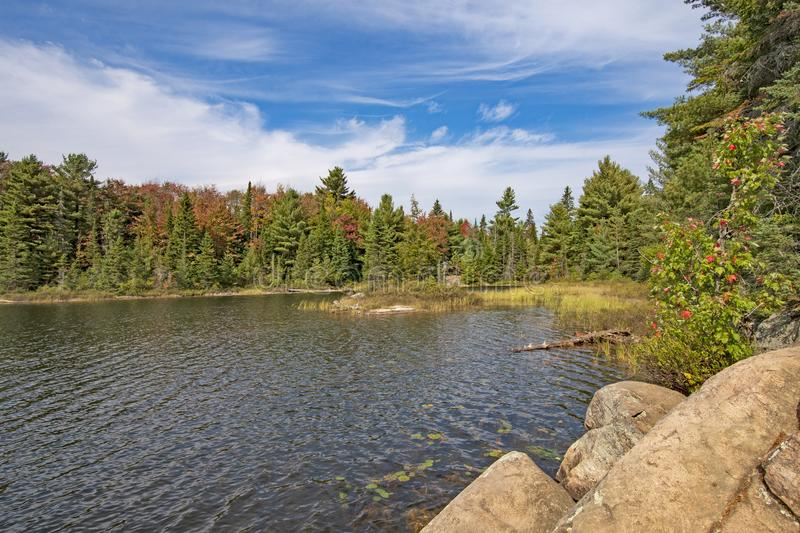 Wilderness Lake as Fall Colors Start to Move In stock photos