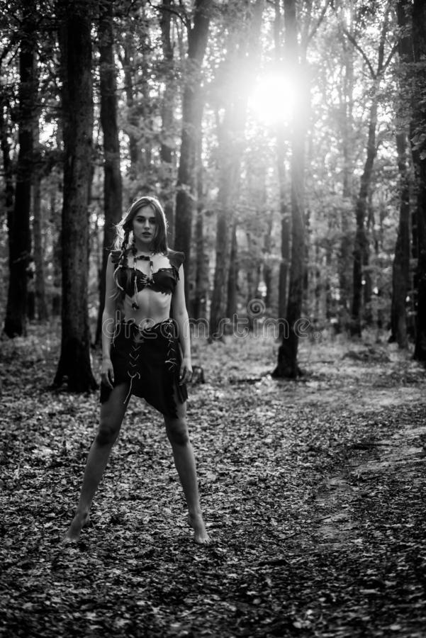 Wilderness of virgin woods. Wild attractive woman in forest. Folklore character. Living wild life untouched nature. Sexy. Girl. Wild human. Female spirit stock photos