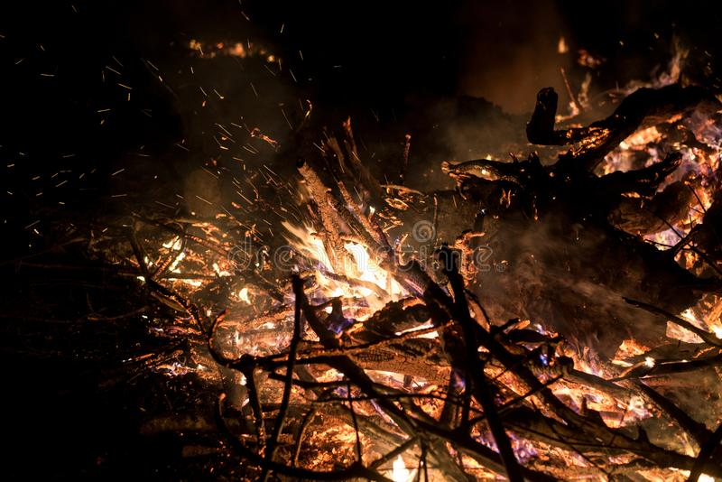 Wildfire burning on grass and wood at night. dangerous place on fire. close-up fire shot. royalty free stock images