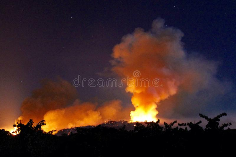 Wildfire smoke plume at night. Wild fires and smoke plume at night lower Lake California stock images
