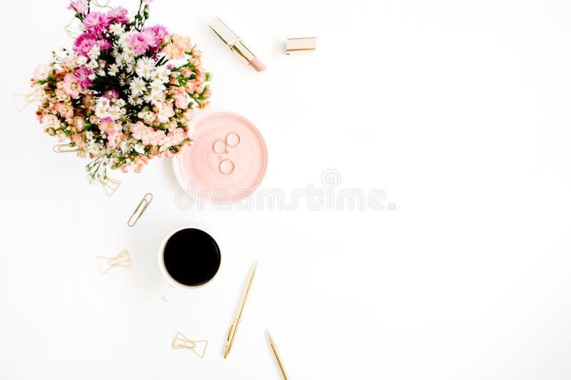 Wildflowers bouquet, coffee cup, golden pen, clips and accessories royalty free stock images