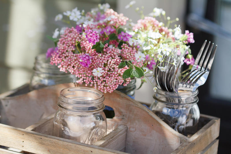 Wildflowers bouquet and forks stock photo