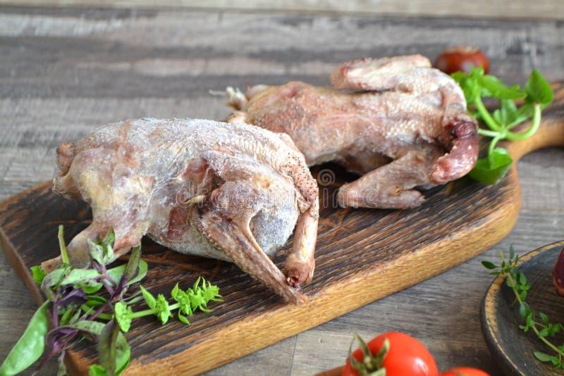 Wildfowl hunting. Two raw woodcock on rustic table, russian cuisine. Wildfowl hunting. Two raw woodcocks on rustic table, russian cuisine stock photo