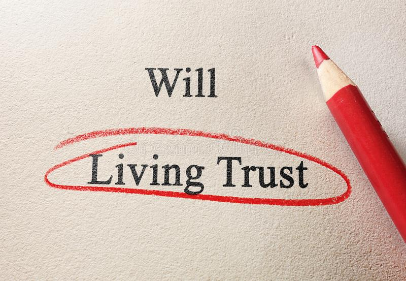 Will or Living Trust. Will and Living Trust text with red pencil circle stock images